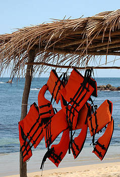 Lifejackets hanging at the ready on a beach in the Huatulco area by Rob Huntley