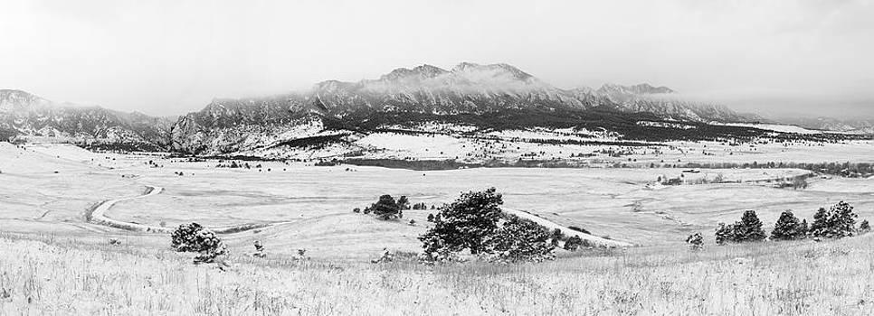 Light Snow on Flatirons by D Scott Clark