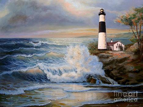 Big Sable Point Lighthouse with crashing waves  by Regina Femrite