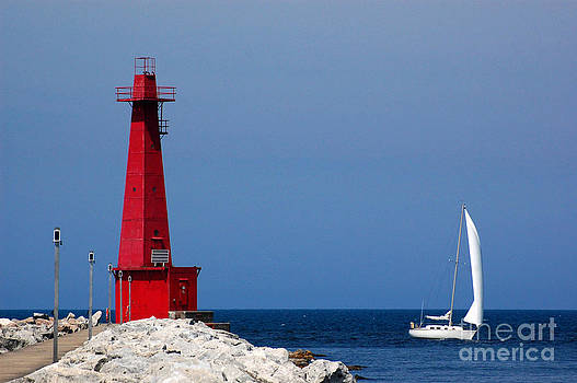 Lighthouse and sailboat in Muskegon by Susan Montgomery