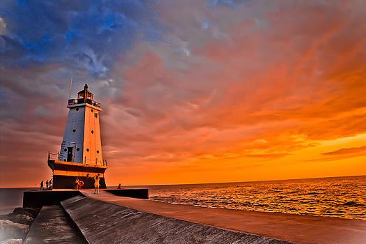 Lighthouse at sunset by Mathieu Beauchesne