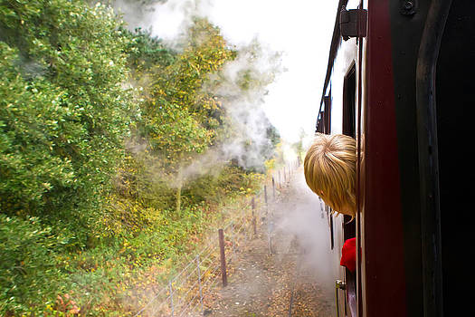Fizzy Image - little boy looking out of a steam train window