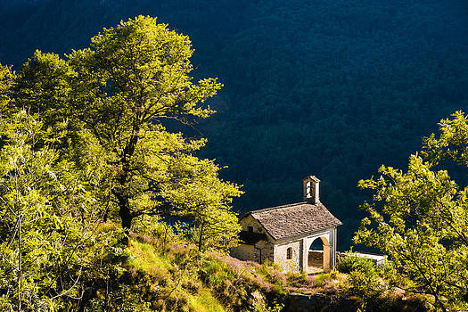 Little Chapel in Ticino with beautiful green trees by Matthias Hauser