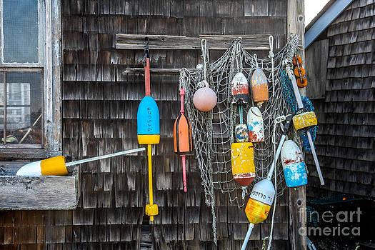 Lobster pot floats and fishing net by Miro Vrlik