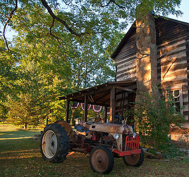 Log Cabin and Tractor by Nickaleen Neff