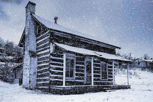 Log Cabin in the Snow by Greg  Booher
