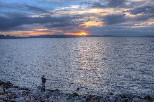 Lone Fisherman at Willard Bay by Rick Otto