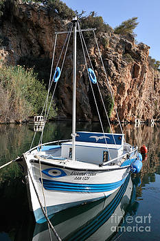George Atsametakis - Lonely boat in Agios Nikolaos