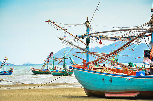 Long Tail Boat Sit On The Beach by Keerati Preechanugoon