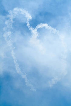 Devinder Sangha - Love sign in sky with aircraft smoke