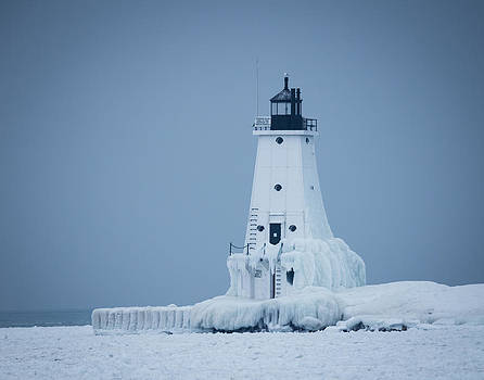Ludington North Pier Lighthouse in Winter by Kimberly Kotzian