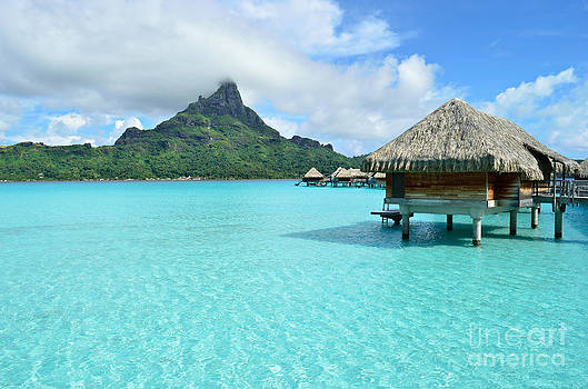Luxury overwater vacation resort on Bora Bora island by IPics Photography