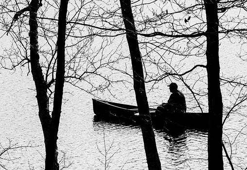 Man And Boat by Paul Geilfuss