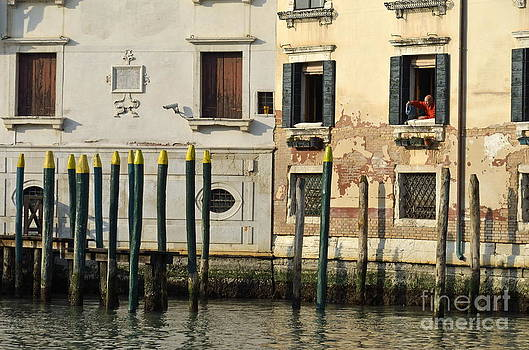Man at window by piers in Venice by Sami Sarkis