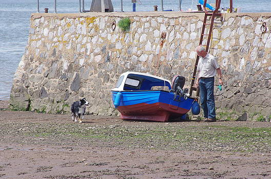Man Dog And Boat  by Tom Salt