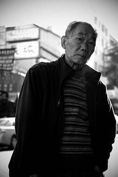 man in Chinatown by Ian Wilson