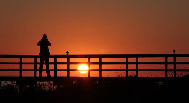 Man on Bridge at Sunset by Chris  Clark