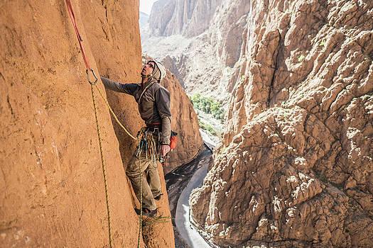 Man Rock Climbing In Todra Gorge, Atlas by Ewa Cie?likiewicz