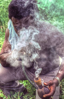 Man taking his Marijuana prescription. by Errol Wilson