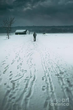 Sandra Cunningham - Man walking in the distance towards a barn