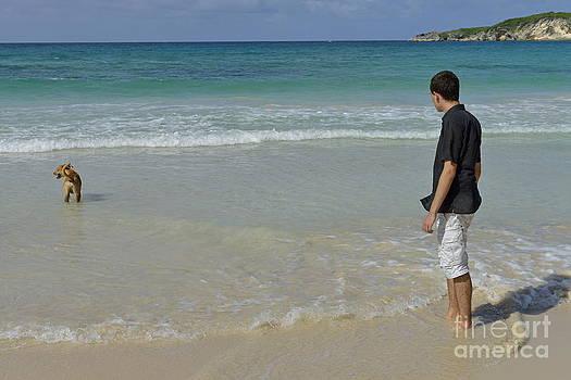 Man with dog contemplating ocean by Sami Sarkis