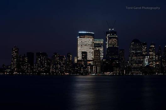 Manhattan Night Skyline by Tone Garot