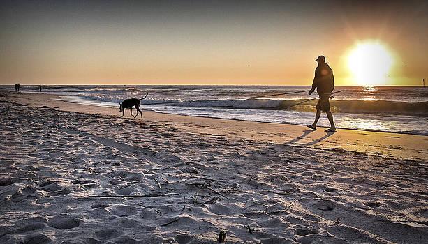 Man's Best Friend on Beach by Phil Mancuso