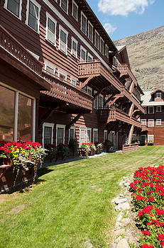Many Glacier Hotel With Flowers by Bruce Gourley