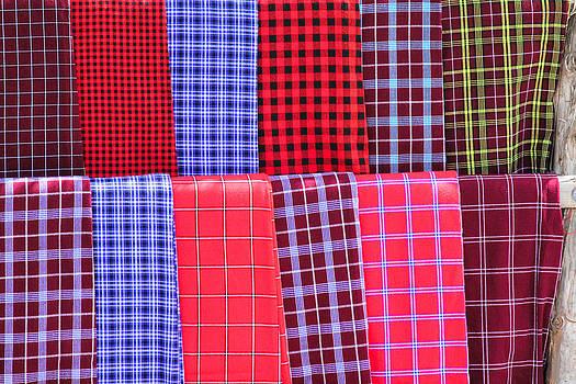 Masaii Blankets at the Market Near Arusha Tanzania by Diane Geddes