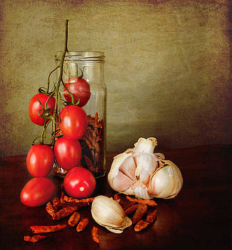 Mediterranean spices and red tomatoes by Luisa Vallon Fumi