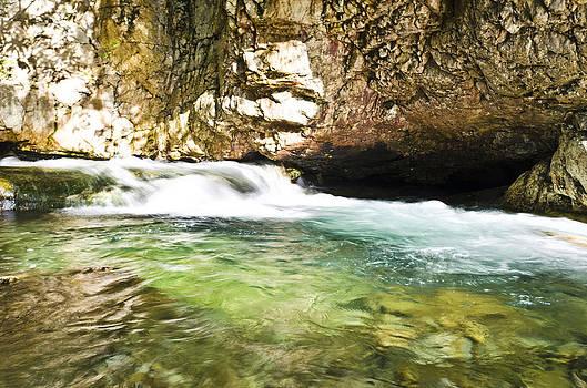 Mini waterfall rushing by Heather Grow