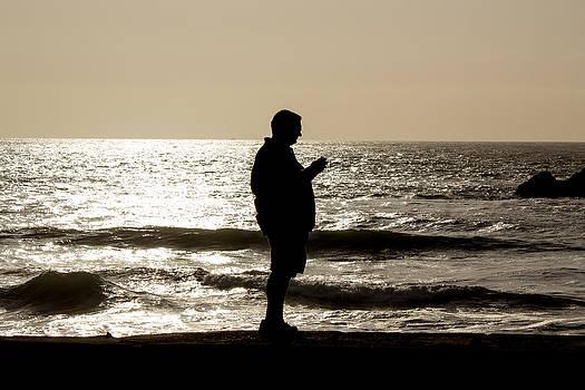 Modern Man looking at Smart Phone by G Matthew Laughton