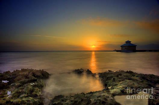 Dan Friend - Morning sun rising in the Grand Caymans
