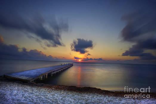 Dan Friend - Morning sunrise on the beach by the dock