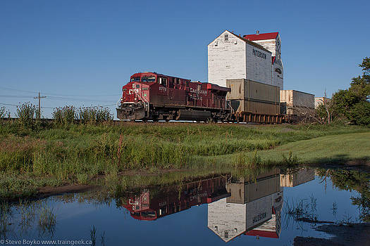 Train Reflection at Mortlach Saskatchewan Grain Elevator by Steve Boyko