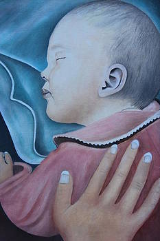 Mother's hand on baby's back by Christine McMillan