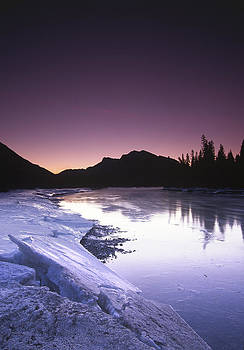 Mount McGillvary silhouetted behind an icy Bow River by Richard Berry