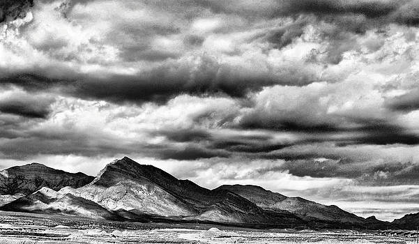 Mountains in Cloudy Silhouette by  Garwerks  Photography