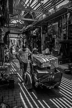 Moving merchandise through the souk by Ellie Perla