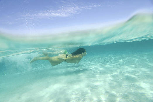 Nano Calvo - Underwater shot of young woman in Formentera