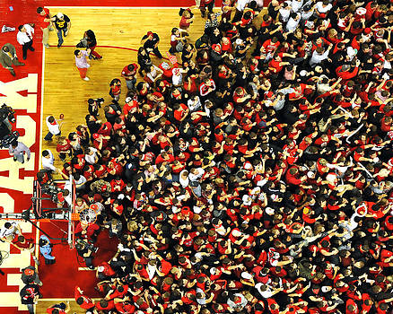 NC State Fans Celebrate at PNC Arena by Replay Photos