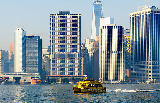 New York Water Taxi Passing Freedom Tower and SI Ferry Terminal by Maureen E Ritter
