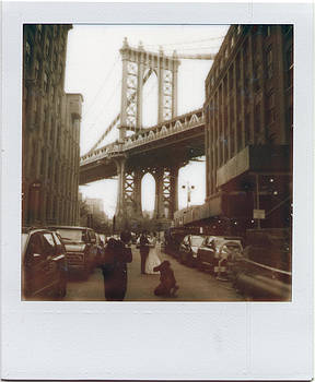 Newlywed Couple being photographed under Manhattan Bridge by Julie VanDore