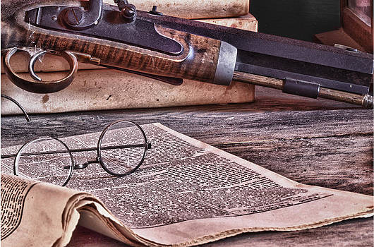 Newspaper Glasses and Pistol by Robert Gaines