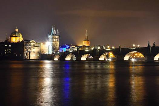 Night Charles bridge in Prague by Tomas Mahring