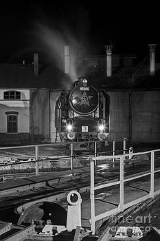 Night shot of a steam engine at the turntable by Christian Spiller