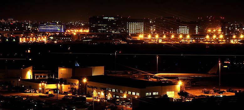 Nighttime airport by Karin Hildebrand Lau