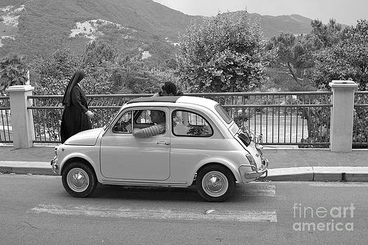 Nun and Classic Fiat Car by James Thomas