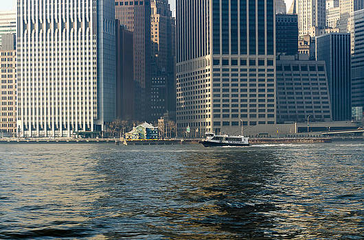 NY Waterway Ferry Passing The Downtown Manhattan Heliport at Pier 6 by Maureen E Ritter