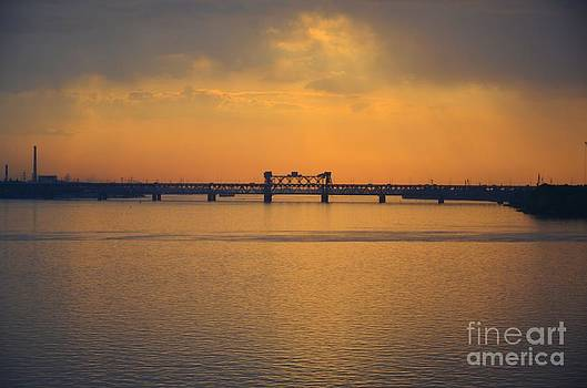 Old bridge above the river Dnepr in city Dnipropetrovsk. by Leonid Nozdrachov